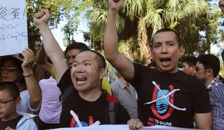 Vietnamese protesters chant anti-Chinese slogans as China moves another oil rig closer to Vietnam's coast. (associated press)