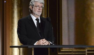 "FILE - In this Nov. 16, 2013 file photo, Producer George Lucas speaks at the 2013 Governors Awards in Los Angeles. The ""Star Wars"" creator Lucas has selected Chicago to house his much anticipated museum of art and movie memorabilia, a spokesman for the mayor's office said Tuesday, June 24, 2014. The decision is a major victory for the nation's third-largest city, which was locked in a battle for the museum with San Francisco. (Photo by Dan Steinberg/Invision/AP, file)"