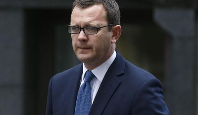 ** FILE ** Andy Coulson, former News of the World editor and aide to British Prime Minister David Cameron, arrives at the Central Criminal Court in London where he will appear to face charges related to phone hacking, Tuesday, June 17, 2014. (AP Photo/Sang Tan)