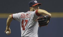 Washington Nationals starting pitcher Gio Gonzalez throws to the Milwaukee Brewers during the first inning of a baseball game Monday, June 23, 2014, in Milwaukee. (AP Photo/Jeffrey Phelps)