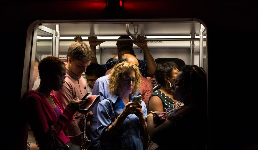 A disabled train outside Stadium-Amory Metro station causes delays at L'Enfant Plaza Metro station Tuesday morning. Crowds waiting for the train would grow to some five people deep. Keith Lane/Special to the Washington Times