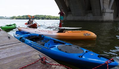Scott Cogan, with his daughters Isabelle, age 9, and Chanel, age 14, from Centreville, MD, took advantage of the warmer weather to paddle along the Potomac river Tuesday afternoon. Keith Lane/Special to the Washington Times