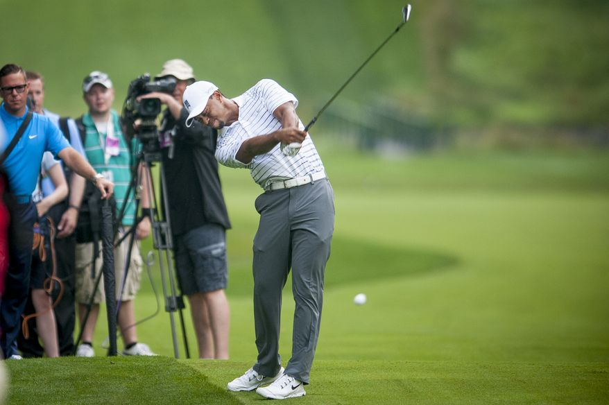 Tiger Woods plays his second shot on the 11th hole during the pro-am at the Quicken Loans National golf tournament being played on Wednesday at Congressional Country Club in Bethesda, Maryland. PHOTO: Pete Marovich Special to The Washington Times