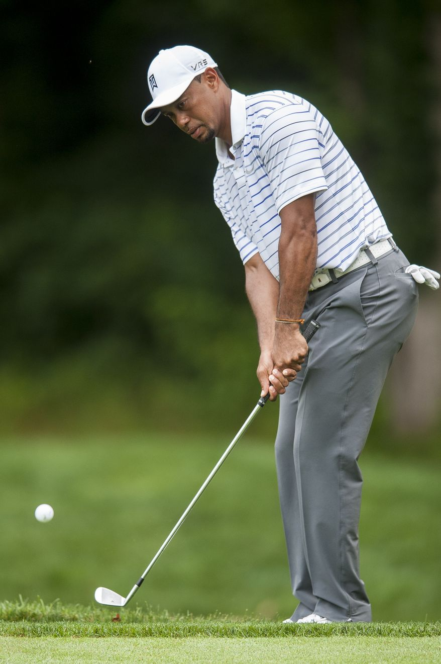 Tiger Woods pays his second shot on the 13th hole during the pro-am at the Quicken Loans National golf tournament being played on Wednesday at Congressional Country Club in Bethesda, Maryland. PHOTO: Pete Marovich Special to The Washington Times