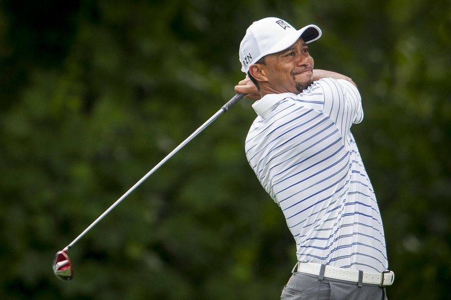 Tiger Woods tees off on the 14th hole during the pro-am at the Quicken Loans National golf tournament being played on Wednesday at Congressional Country Club in Bethesda, Maryland. PHOTO: Pete Marovich Special to The Washington Times