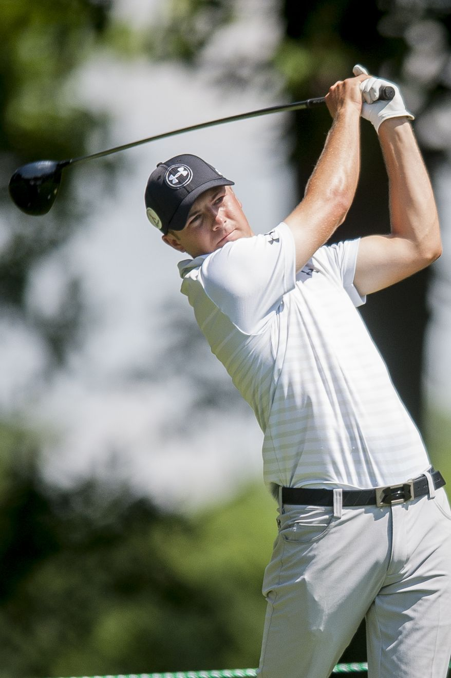 Jordan Spieth hits his tee shot on the par-4, 4th hole during the pro-am at the Quicken Loans National golf tournament being played on Wednesday at Congressional Country Club in Bethesda, Maryland. PHOTO: Pete Marovich Special to The Washington Times