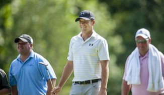 Jordan Spieth walks off the gree with his group on the par-5, 6th hole during the pro-am at the Quicken Loans National golf tournament being played on Wednesday at Congressional Country Club in Bethesda, Maryland. PHOTO: Pete Marovich Special to The Washington Times