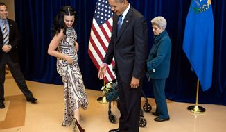 President Barack Obama comments on Katy Perry's shoes while greeting the singer and her grandmother, Ann Hudson, at Doolittle Park in Las Vegas, Nev., Oct. 24, 2012. (Official White House Photo by Pete Souza)