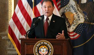"""Utah Gov. Gary Herbert speaks during a news conference Wednesday, June 25, 2014, in Salt Lake City. A federal appeals court on Wednesday ruled for the first time that states must allow gay couples to marry, finding the Constitution protects same-sex relationships and putting a remarkable legal winning streak across the country one step closer to the U.S. Supreme Court. Herbert said he was disappointed with the panel's decision and believes states should determine their own laws regarding same-sex marriage. He hopes the high court will rule on the issue to provide clarity. """"We can't get finality and final resolution unless the Supreme Court hears the case and makes a decision,"""" Herbert said at a news conference. (AP Photo/Rick Bowmer)"""