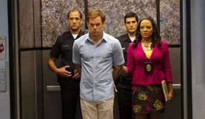 """Michael C. Hall, front left, as Dexter Morgan and Lauren Velez as Maria LaGuerta in a scene from Showtime's """"Dexter,"""" appear in the undated promotional photo for Season 7, episode 12. (Associated Press)"""