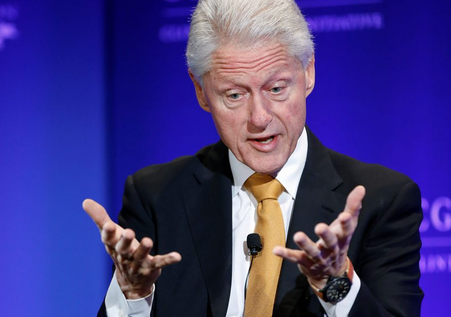 """Former President Bill Clinton gestures during a televised conversation hosted by Bloomberg TV titled """"A New Competitive Era: America in the World,"""" on the final day of the annual gathering of the Clinton Global Initiative America, at the Sheraton Downtown, in Denver, Wednesday, June 25, 2014. (AP Photo/Brennan Linsley)"""