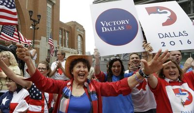Republican supporters cheer outside the American Airlines Center during a visit by members of the Republican National Committee scouting a 2016 Convention host site in Dallas, Thursday, June 12, 2014. (AP Photo/LM Otero)