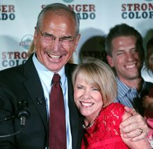 Republican gubernatorial candidate Bob Beauprez hugs his wife Claudia as they celebrate after winning the GOP primary at an election party in Denver on Tuesday, June 24, 2014. Beauprez defeated Scott Gessler, Tom Tancredo, and Mike Kopp  for the Republican nomination to oppose democratic Gov. John Hickenlooper in November's election. (AP Photo/Ed Andrieski)