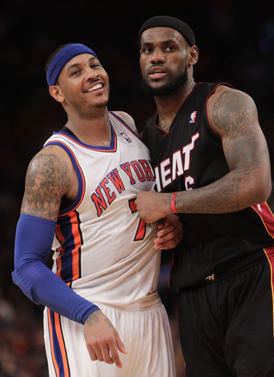 New York Knicks' Carmelo Anthony, left, and Miami Heat's LeBron James jockey for position in the second half of an NBA basketball game in New York, Sunday, April 15, 2012. The Heat defeated the Knicks 93-85. (AP Photo/Seth Wenig)