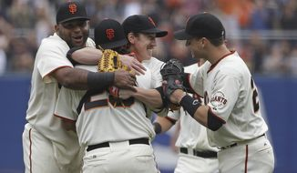 San Francisco Giants pitcher Tim Lincecum, center, is embraced by teammates, from left, Pablo Sandoval, catcher Hector Sanchez, and Buster Posey after throwing a no-hitter against the San Diego Padres a baseball game Wednesday, June 25, 2014, in San Francisco. Lincecum threw his second career no-hitter as San Francisco won 4-0. (AP Photo/Eric Risberg)