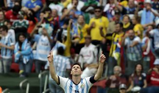 Argentina's Lionel Messi celebrates scoring his side's second goal during the group F World Cup soccer match between Nigeria and Argentina at the Estadio Beira-Rio in Porto Alegre, Brazil, Wednesday, June 25, 2014. (AP Photo/Fernando Vergara)