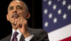President Barack Obama speaks at the League of Conservation Voters Capitol Dinner at the Ronald Reagan Building on Wednesday, June 25, 2014, in Washington. (AP Photo/Jacquelyn Martin)