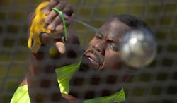 Kibwe Johnson winds up to throw during the men's hammer throw final at the U.S. outdoor track and field championships, Thursday, June 26, 2014, in Sacramento, Calif. Johnson won the event. (AP Photo/Mark J. Terrill)