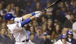 Chicago Cubs' Justin Ruggiano hits a two-run double against the Washington Nationals during the seventh inning of a baseball game in Chicago, Thursday, June 26, 2014. (AP Photo/Nam Y. Huh)