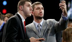 NBA Draft prospects Jusuf Nurkic, of Bosnia, left, and Vasilije Micic, of Serbia, pose for a selfie before the start of the 2014 NBA draft, Thursday, June 26, 2014, in New York. (AP Photo/Jason DeCrow)