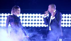"FILE - This Jan. 26, 2014 file photo shows Beyonce, left, and Jay Z performing ""Drunk in Love"" at the 56th annual Grammy Awards in Los Angeles. Jay Z is hitting the road with his superstar wife, Beyonce. The On the Run Tour kicks off Wednesday, June 25, 2014, in Miami.  (Photo by Matt Sayles/Invision/AP, File)"