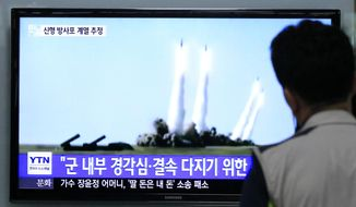 "A man watches a TV news program showing the missile launch conducted by North Korea, at Seoul Railway Station in Seoul, South Korea, Thursday, June 26, 2014. North Korea fired three short-range projectiles Thursday into the waters off its east coast, a South Korean defense official said. The move was most likely a routine test-firing, but the official said it could also be meant to stoke tensions with Seoul. The writing on tje screen reads ""The missiles were launched to alert and express its internal solidarity."" (AP Photo/Ahn Young-joon)"