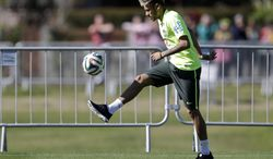 Brazil's Neymar practices during a training session in Teresopolis, Brazil, Wednesday, June 25, 2014. Brazil will face Chile on June 28 in the round of 16 of the 2014 soccer World Cup. (AP Photo/Andre Penner)