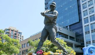 Flowers left in memoriam at the statue of Tony Gwynn in front of Petco Park, San Diego, California            Associated Press photo