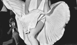 """**FILE** Marilyn Monroe poses over the updraft of New York subway grating while in character for the filming of """"The Seven Year Itch"""" in Manhattan on Sept. 9, 1954. (Associated Press)"""