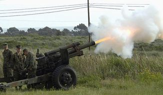 Marines from 11th Marines, 1st Marine Division fire a M101 105 mm Howitzer at Camp Pendleton, California. A gun like this one was fired at the Oklahoma Full Auto Shoot and Trade Show. (Wikimedia Commons)