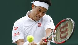 Kei Nishikori of Japan plays a return to Denis Kudla of the U.S. during their men's singles match at the All England Lawn Tennis Championships in Wimbledon, London, Thursday, June 26, 2014. (AP Photo/Alastair Grant)