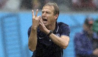 United States' head coach Juergen Klinsmann gestures during the group G World Cup soccer match between the USA and Germany at the Arena Pernambuco in Recife, Brazil, Thursday, June 26, 2014. (AP Photo/Matthias Schrader)