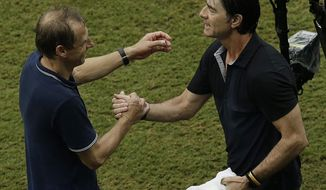 United States' head coach Juergen Klinsmann, left and Germany's head coach Joachim Loew greet each other after the group G World Cup soccer match between the USA and Germany at the Arena Pernambuco in Recife, Brazil, Thursday, June 26, 2014. Germany beat the United States 1-0. (AP Photo/Hassan Ammar)