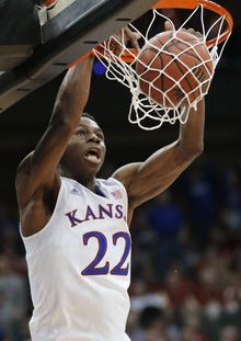 FILE - In this March 13, 2014 file photo, Kansas guard Andrew Wiggins dunks during the second half of an NCAA college basketball game against Oklahoma State in the quarterfinals of the Big 12 Conference men's tournament in Kansas City, Mo. (AP Photo/Orlin Wagner, File)