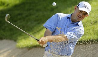 Greg Chalmers, of Australia, hits out of a bunker onto the 11th green during the first round of the Quicken Loans National PGA golf tournament, Thursday, June 26, 2014, in Bethesda, Md. (AP Photo/Patrick Semansky)