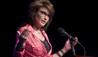 ** FILE ** Former Alaska governor and Republican vice presidential nominee Sarah Palin speaks to the crowd in Sevierville, Tenn., on Thursday, June 26, 2014. (AP Photo/The Knoxville News Sentinel, Saul Young)