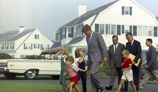 In this Aug. 26, 1963 photo provided by the John F. Kennedy Library and Museum, President Kennedy approaches a helicopter at the family home in Hyannis Port, Mass., for the first leg of his journey back to Washington. Accompanying him are from left: Sydney Lawford, John F. Kennedy, Jr., Caroline Kennedy, the President, Secret Service Agent Sam Sulliman, David Kennedy, Agents Jerry Behn and Tom Wells. The JFK library opened a special exhibit Friday, June 27, 2014, featuring some never-before displayed artifacts from the Kennedy family's summers on Cape Cod. (AP Photo/White House via the John F. Kennedy Library and Museum in Boston, Cecil Stoughton)