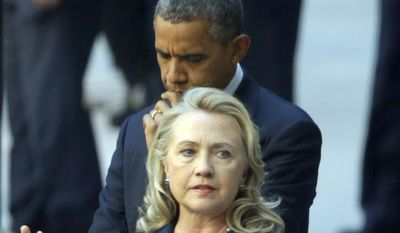 **FILE** Secretary of State Hillary Rodham Clinton, accompanied by President Obama, meets Sept. 12, 2012, with State Department personnel in the courtyard of the State Department building in Washington after the president spoke at the White House concerning the recent deaths of Americans in Libya. (Associated Press)