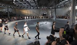 Models wear creations by Italian designer Riccardo Tisci as part of Givenchy men's Spring-Summer 2015 fashion collection, presented in Paris, Friday, June 27, 2014. (AP Photo/Jacques Brinon)