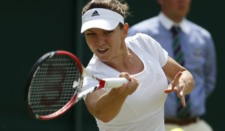 Simona Halep of Romania plays a return to Lesia Tsurenko of Ukraine during their women's singles match at the All England Lawn Tennis Championships in Wimbledon, London, Friday, June 27, 2014. (AP Photo/Alastair Grant)
