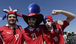 Fans of chile national soccer team pose for photos prior the World Cup round of 16 match between Brazil and Chile at the Mineirao Stadium in Belo Horizonte, Brazil, Saturday, June 28, 2014. (AP Photo/Petr David Josek)