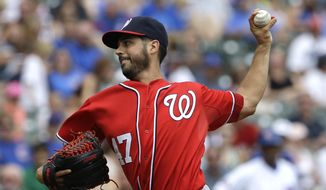 Washington Nationals starter Gio Gonzalez throws against the Chicago Cubs during the first inning of a baseball game in Chicago, Saturday, June 28, 2014.  (AP Photo/Nam Y. Huh)