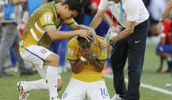 Brazil's Neymar reacts after the  penalty shoot-out during the World Cup round of 16 soccer match between Brazil and Chile at the Mineirao Stadium in Belo Horizonte, Brazil, Saturday, June 28, 2014. Brazil won 3-2 on penalties.(AP Photo/Frank Augstein)