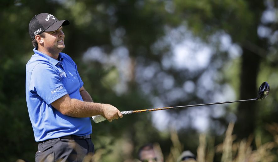 Patrick Reed watches his shot on the 16th tee during the third round of the Quicken Loans National PGA golf tournament, Saturday, June 28, 2014, in Bethesda, Md. (AP Photo/Patrick Semansky)