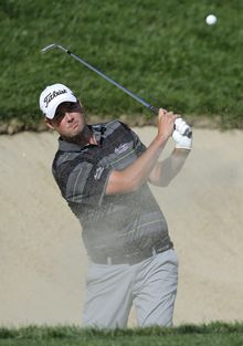 Marc Leishman, of Australia, hits out of a sand trap onto the 17th green during the third round of the Quicken Loans National PGA golf tournament, Saturday, June 28, 2014, in Bethesda, Md. (AP Photo/Patrick Semansky)