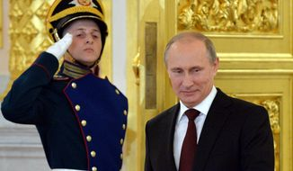 Russian President Vladimir Putin enters the Alexander Hall to attend a ceremony of presentation of credentials by foreign ambassadors in the Grand Kremlin Palace in Moscow, Friday, June 27, 2014. (AP Photo/Yuri Kadobnov, Pool)