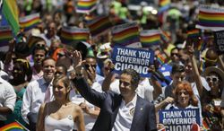 New York Gov. Andrew Cuomo marches in the Gay Pride Parade in New York, Sunday, June 29, 2014. Fifth Avenue became one big rainbow on Sunday, as thousands of participants waving multicolored flags made their way down the street for New York City's annual Gay Pride march. (AP Photo/Seth Wenig)