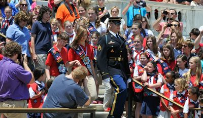 Members of the American Heritage Girls are escorted by a soldier from the 3rd Infantry Regiment to the base of the Tomb of the Unknown Soldiers on Sunday, June 29 at Arlington National Cemetery Memorial Amphitheater. Khalid Naji-Allah/Special to The Washington Times.