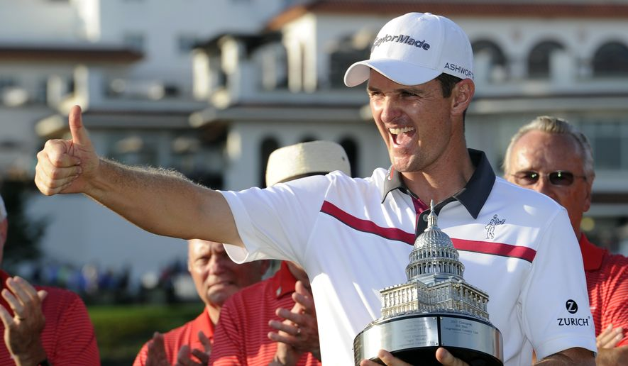 Justin Rose, of England, poses with the trophy after he won the Quicken Loans National golf tournament, Sunday, June 29, 2014, in Bethesda, Md. (AP Photo/Nick Wass)