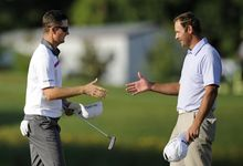 Justin Rose, left, of England, shakes hands with Shawn Stefani after Rose won the Quicken Loans National PGA golf tournament in a playoff round against Stefani, Sunday, June 29, 2014, in Bethesda, Md. (AP Photo/Nick Wass)